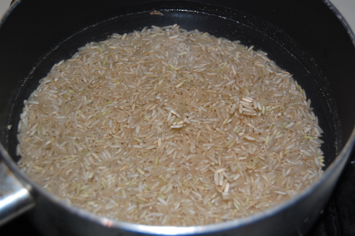 Combine 1 C of rice and 2 C of water if you are using regular, not quick cook rice.  Bring to a boil, reduce the heat, cover and simmer until the water is absorbed and rice is tender.  If you are using a quick cook rice, follow package instructions.