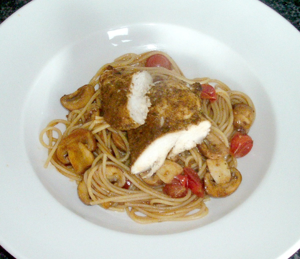 Bolognaise spiced baked chicken breast is served on a bed of spaghetti with tomatoes and mushrooms