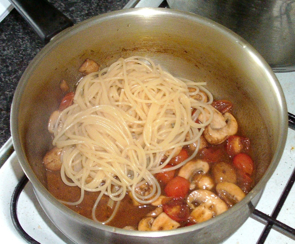 Drained spaghetti is added to sauce