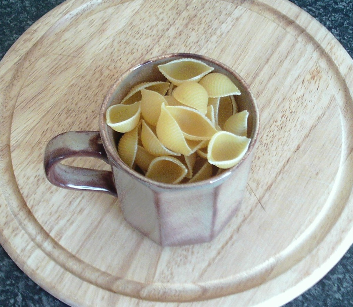 Mug of dried pasta