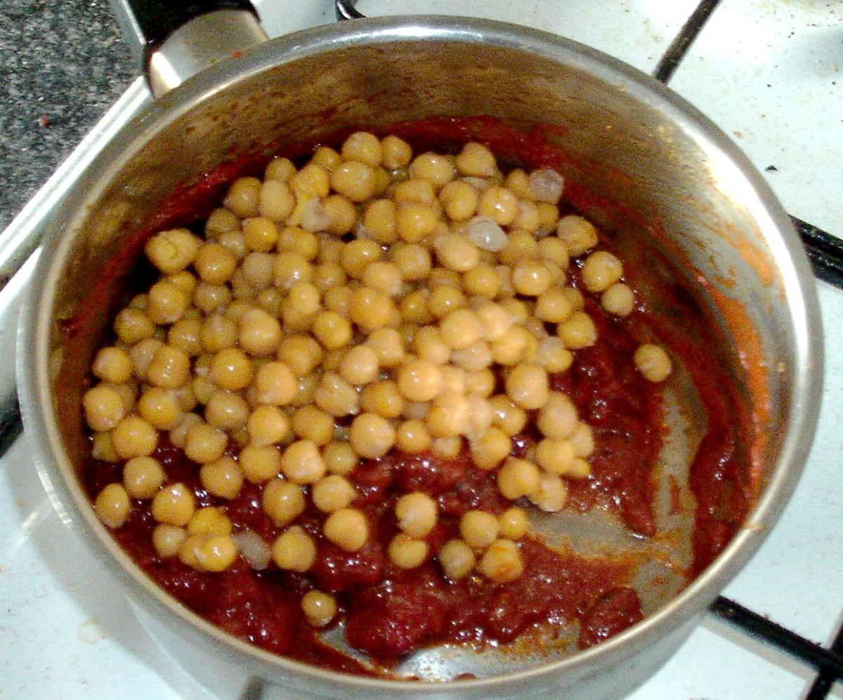 Chickpeas are added to spicy sauce
