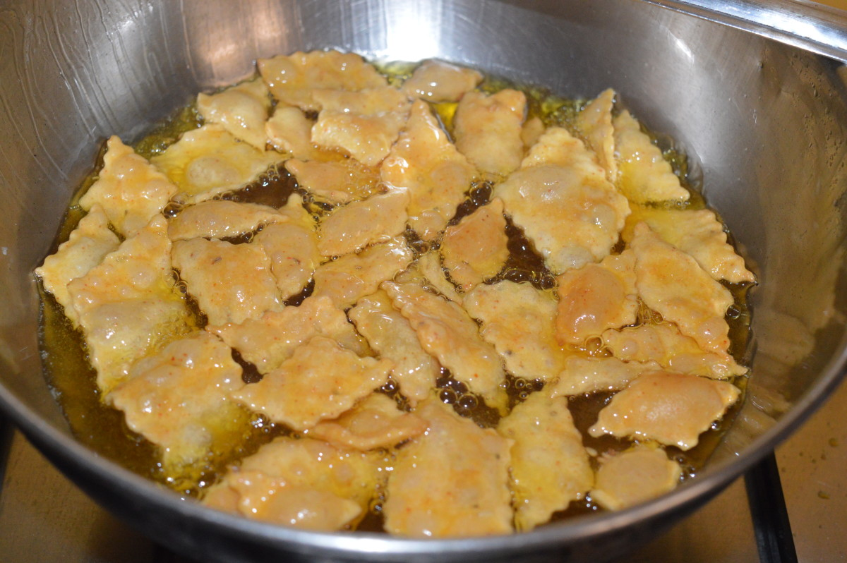 Step seven: Fry them on medium heat till they become golden, while turning them occasionally to ensure uniform frying.