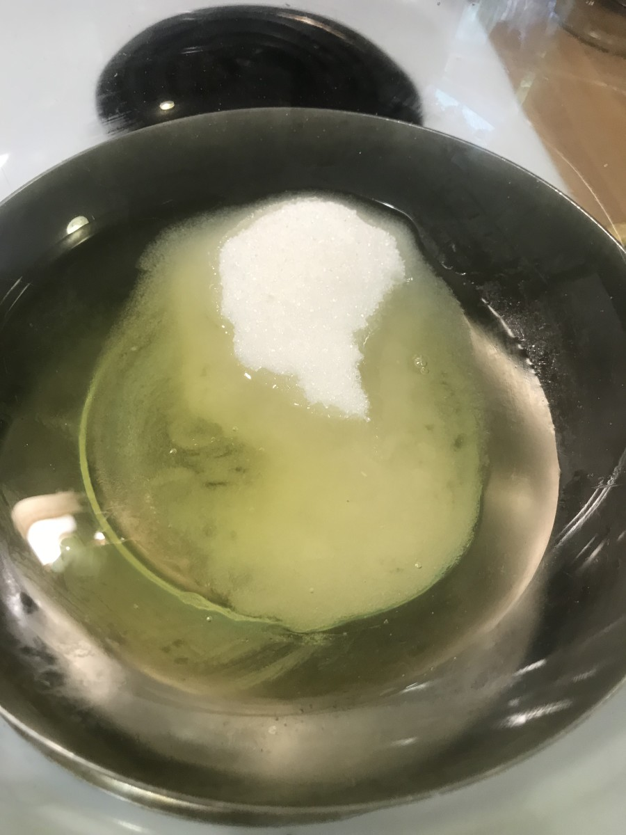 Whisk together sugar and egg whites over barely simmering water. Whisk until the sugar is fully dissolves and the egg whites turn white and frothy.