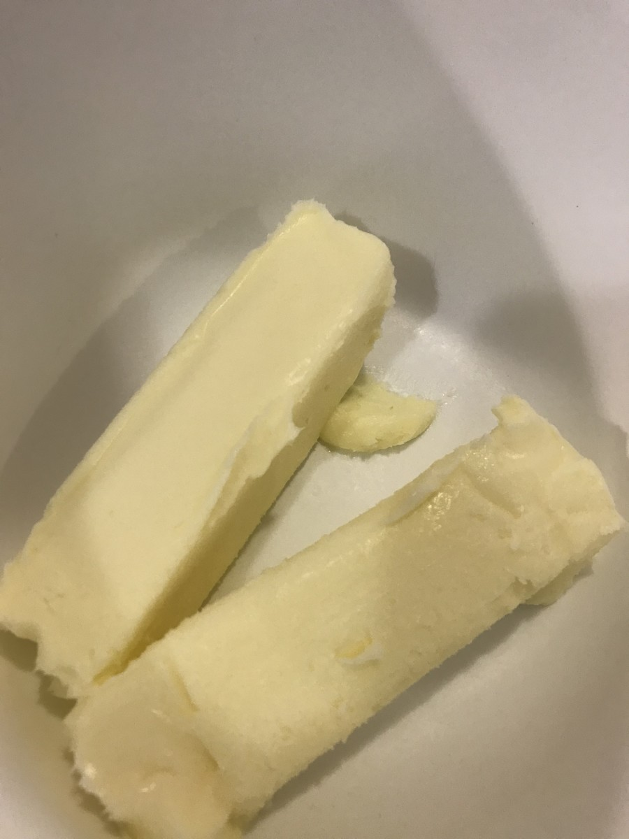 Start with a cup - 2 sticks - of real butter, at room temperature. Room temperature butter will whip more easily, and become fluffier. It's also easier to incorporate the powdered sugar  without lumps. Real butter - not margarine - is a must.