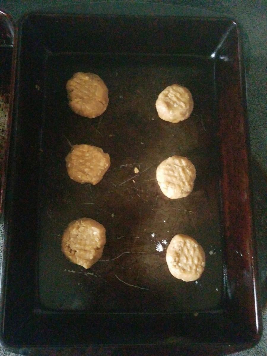 Optional: dip a fork in flour and make a criss-cross pattern across each ball.