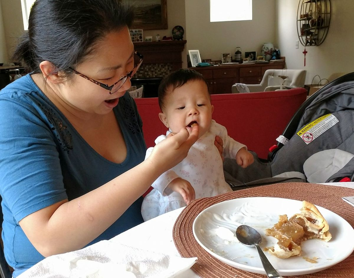 Grandbaby Anna's first taste of my farmhouse apple slab pie with Chinese Sugar.  She loved it!