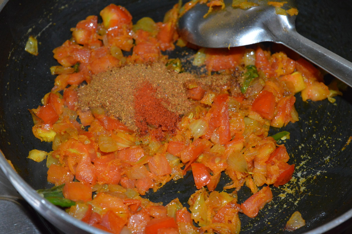 Step 6: Add chole masala powder. Saute until the raw smell disappears from the masala.