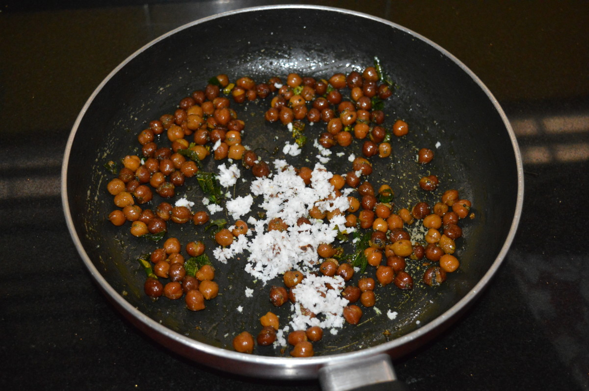 Step nine: Throw in grated coconut. Thoroughly mix once again. Turn off the fire. Your chickpea stuffing is ready.