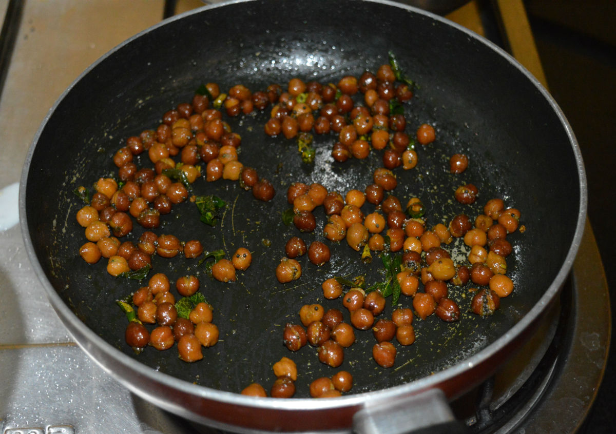 Step eight: Throw in cooked chickpeas. Add sugar and very little salt. Mix well.