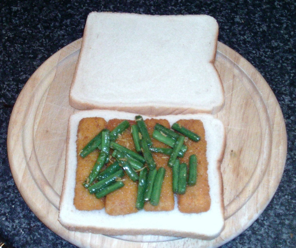 Sauteed green beans with chilli, garlic and fenugreek on fish fingers sandwich