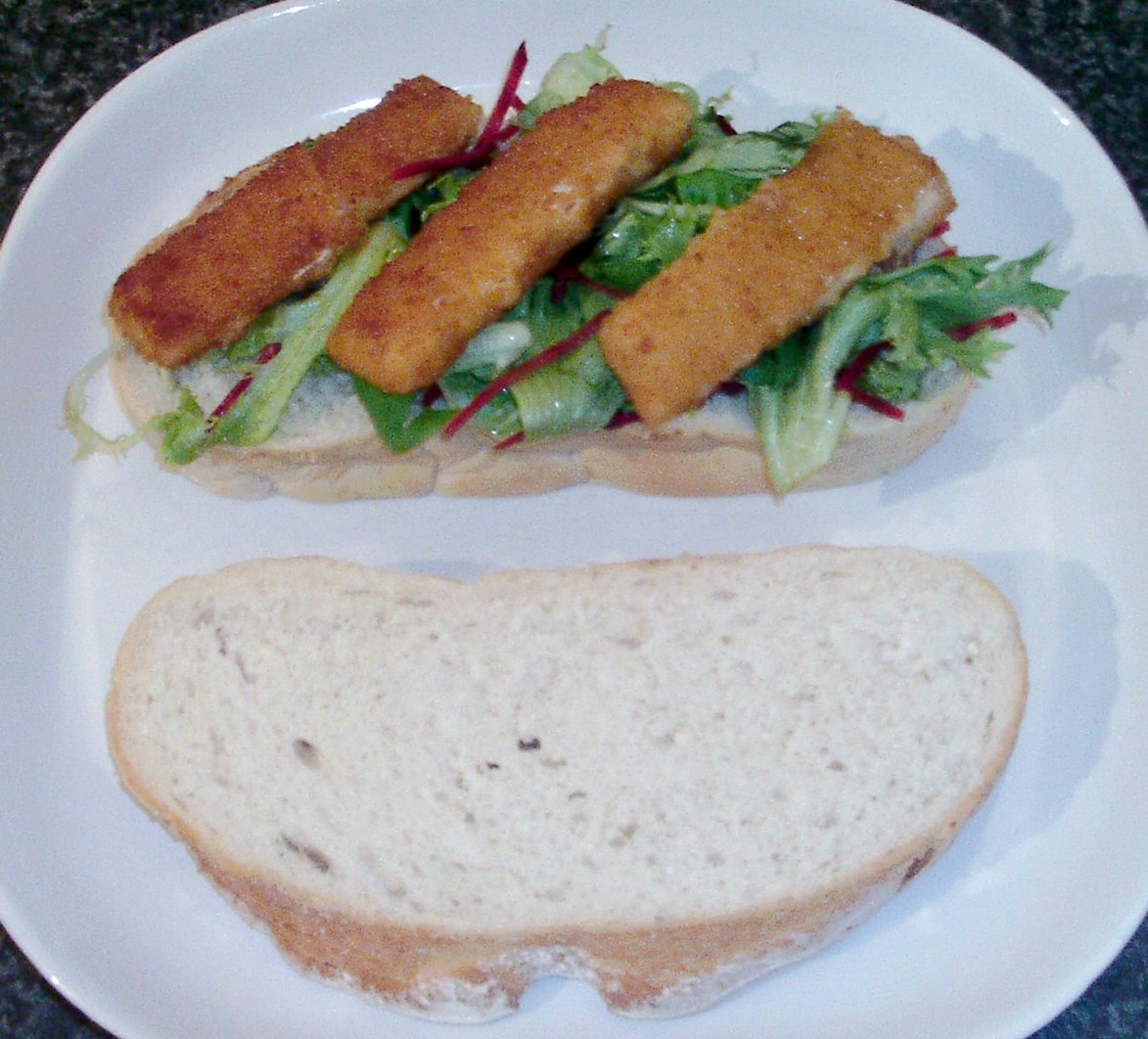 Fish fingers on salad bed