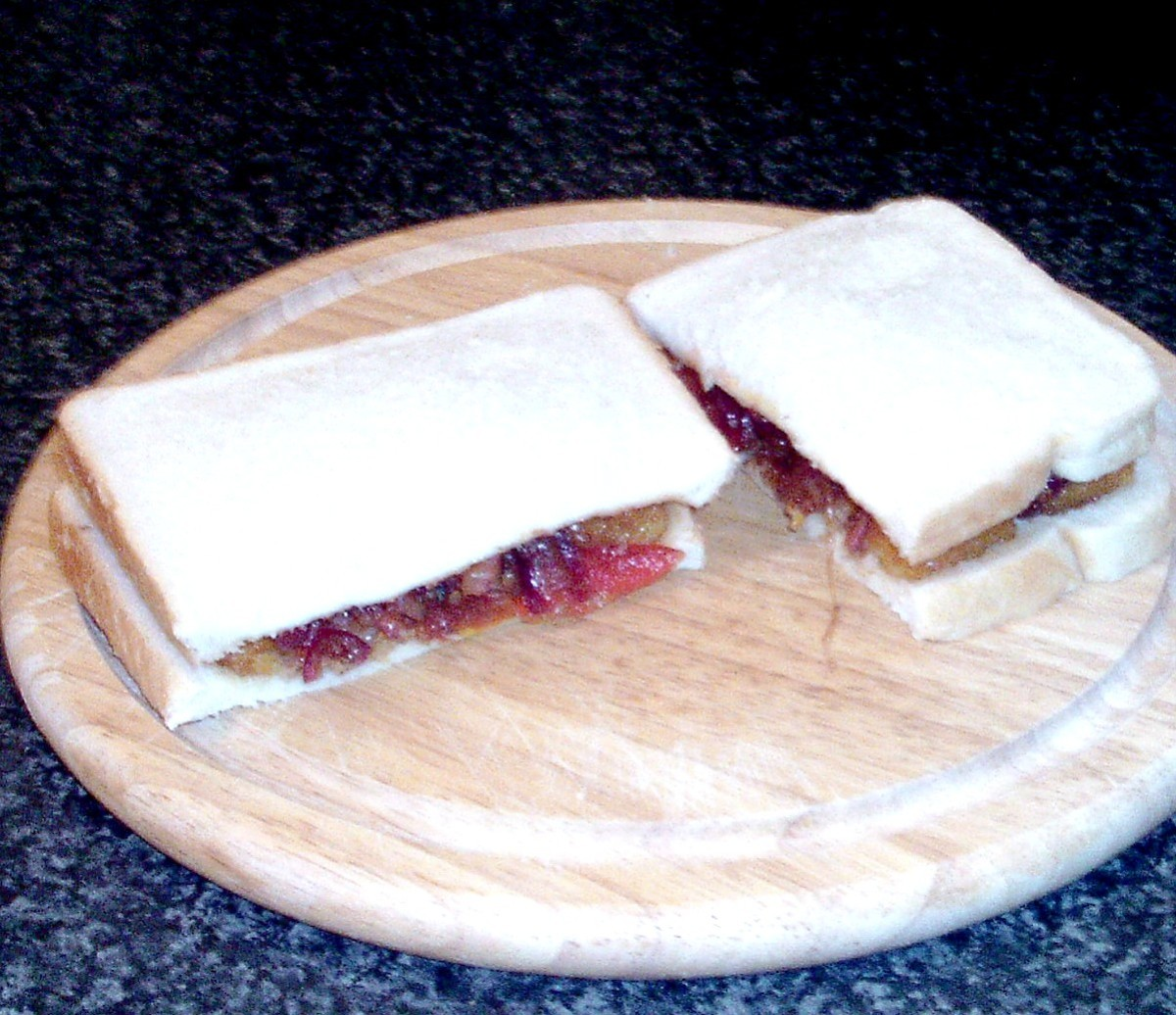 Cut to serve fish fingers and balsamic tomato sauce sandwich