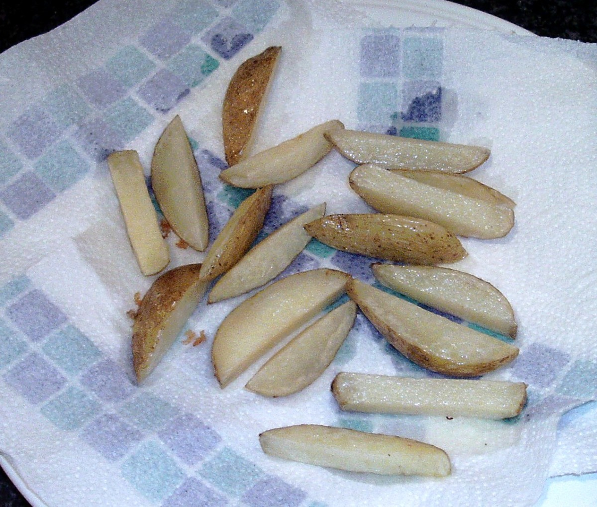 Once fried chips are drained on kitchen paper