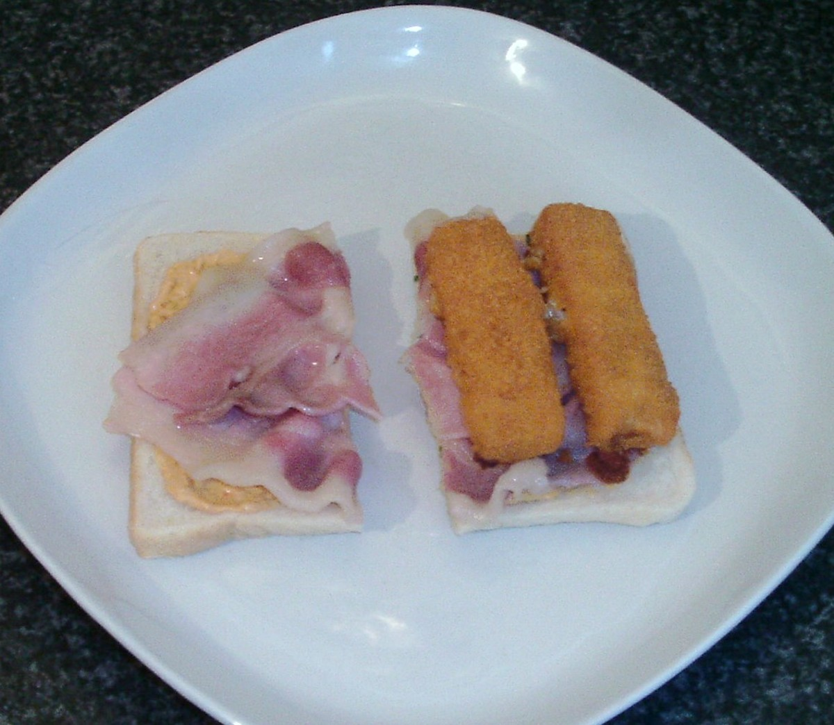 Fish fingers are laid on bacon