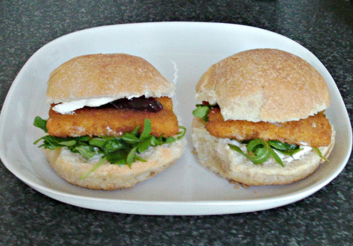 Closed over fish finger, cream cheese and rocket bread rolls