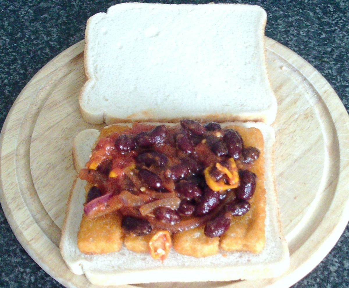 Fish fingers topped with red kidney beans in spicy tomato sauce