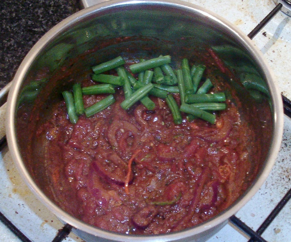 Green beans are added to curry sauce