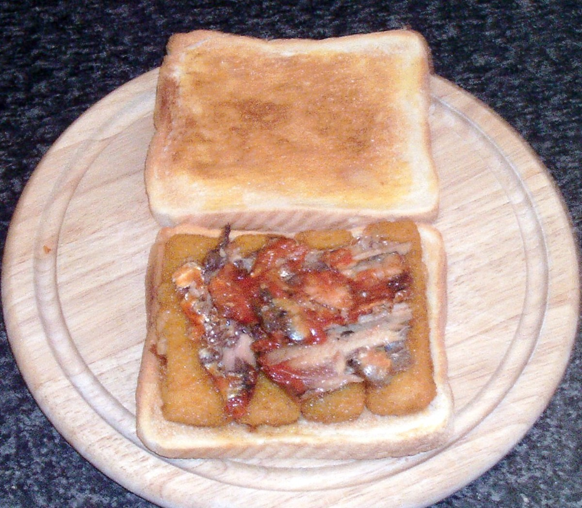Canned sardines spread on fish fingers