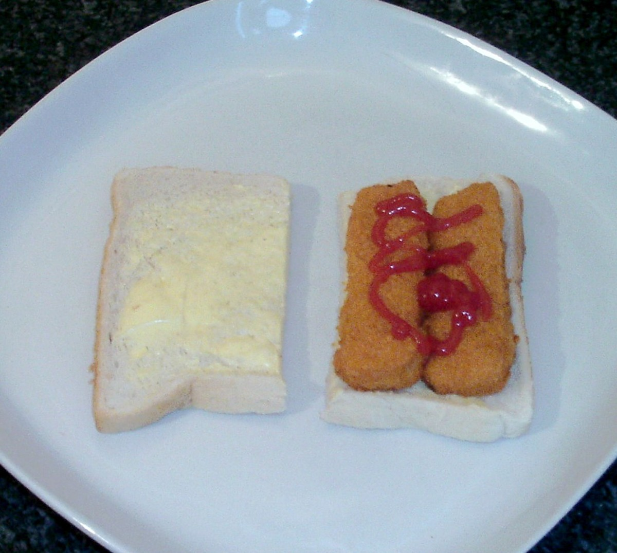 Basic and popular fish finger and tomato ketchup sandwich