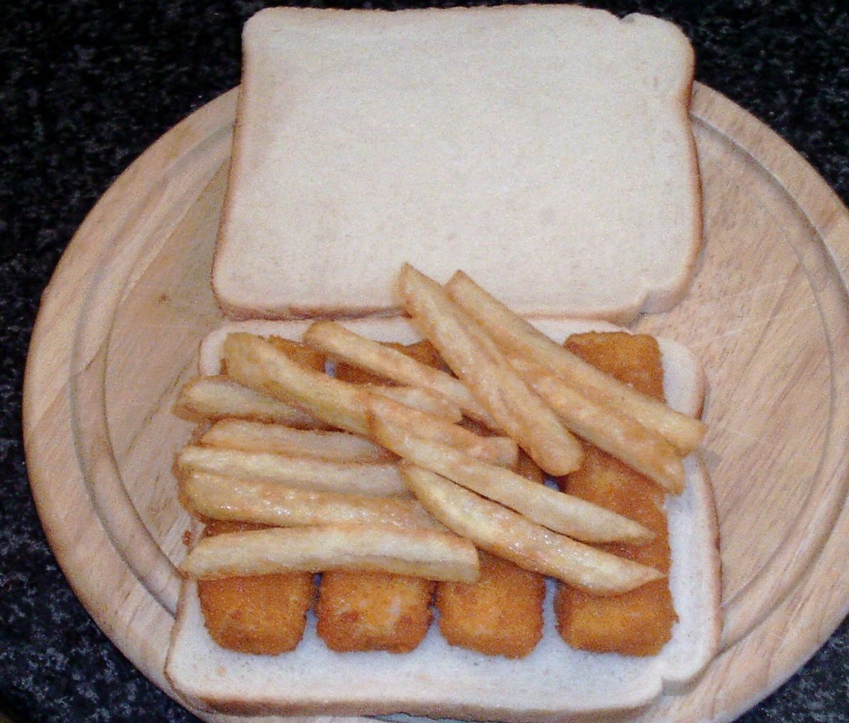 Chips are placed on top of fish fingers