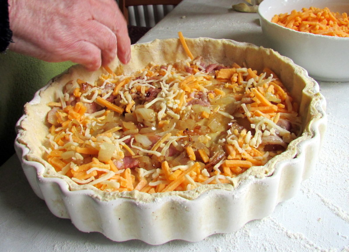 Place the ingredients into the quiche pastry.