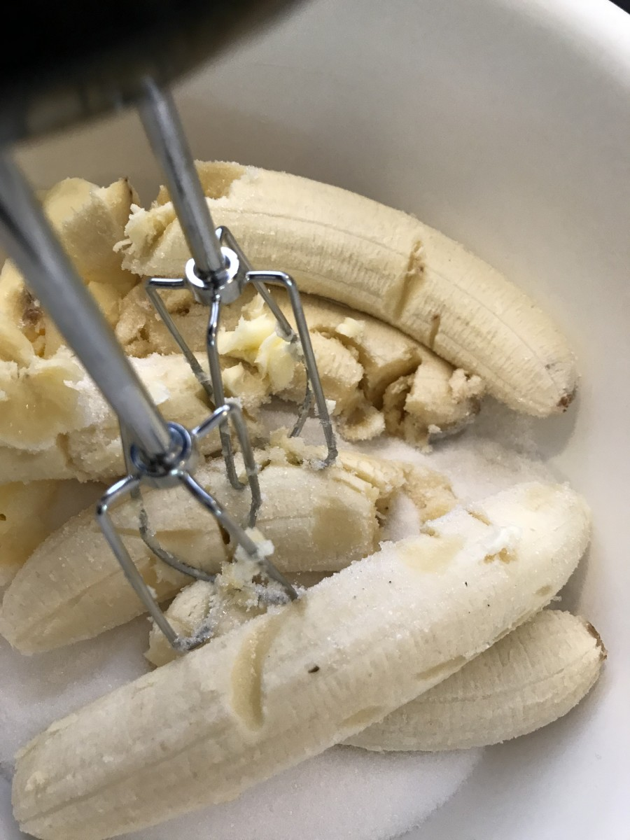 Go ahead and throw the bananas in when you're creaming together the butter and sugar. I find that you get a beautiful texture and consistency in the finished bread when you do this. The banana is mashed up and incorporated much better this way.