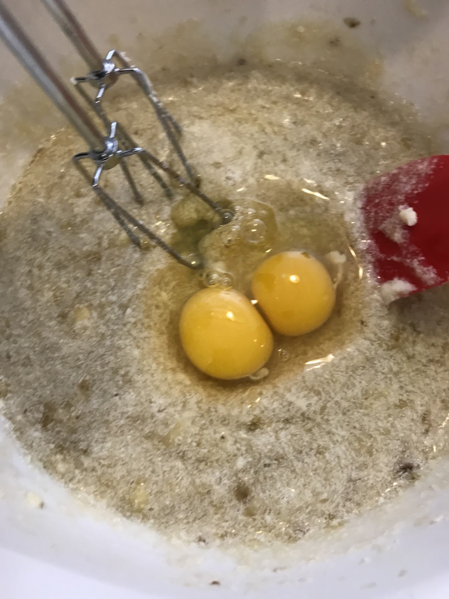 Once the butter and sugar are completely beaten with the bananas, add the eggs, beating after each one and scraping down the sides of the bowl. As you can see, if you accidentally add both at once, the world won't end.