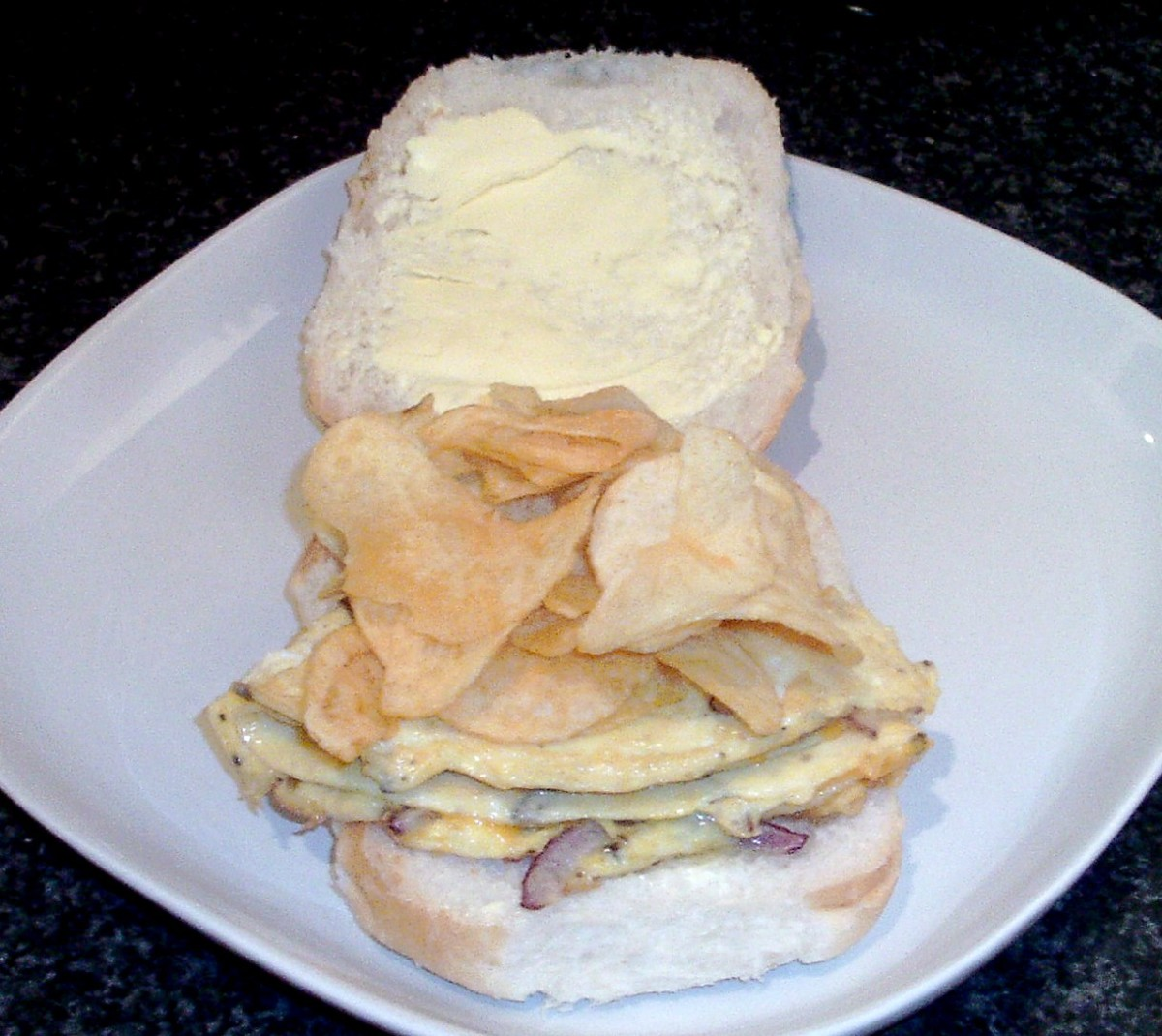 Cheese and onion crisps are laid on omelette