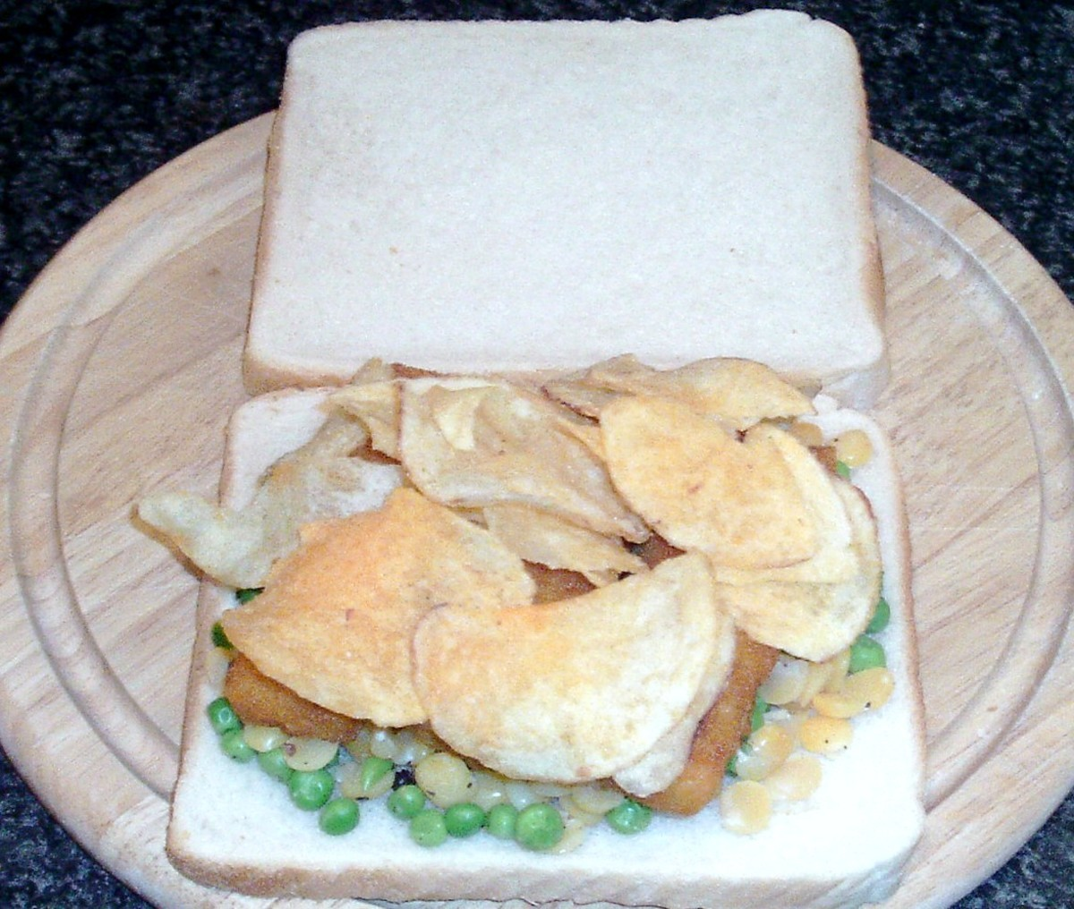 Cheese and onion crisps are laid on fish fingers