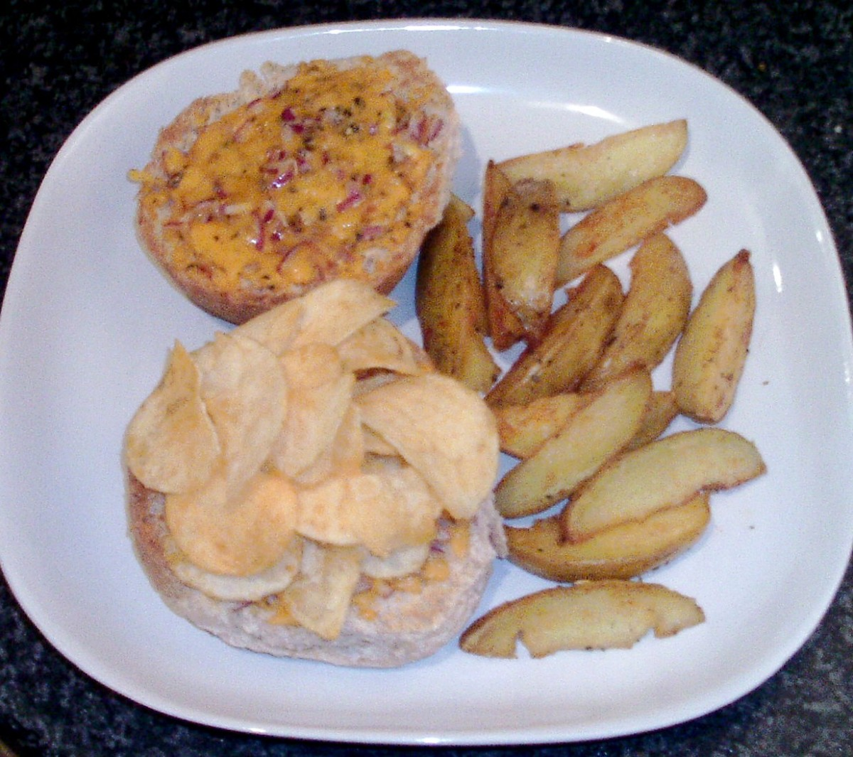 Melted cheese and onion with cheese and onion crisps sandwich and wedges