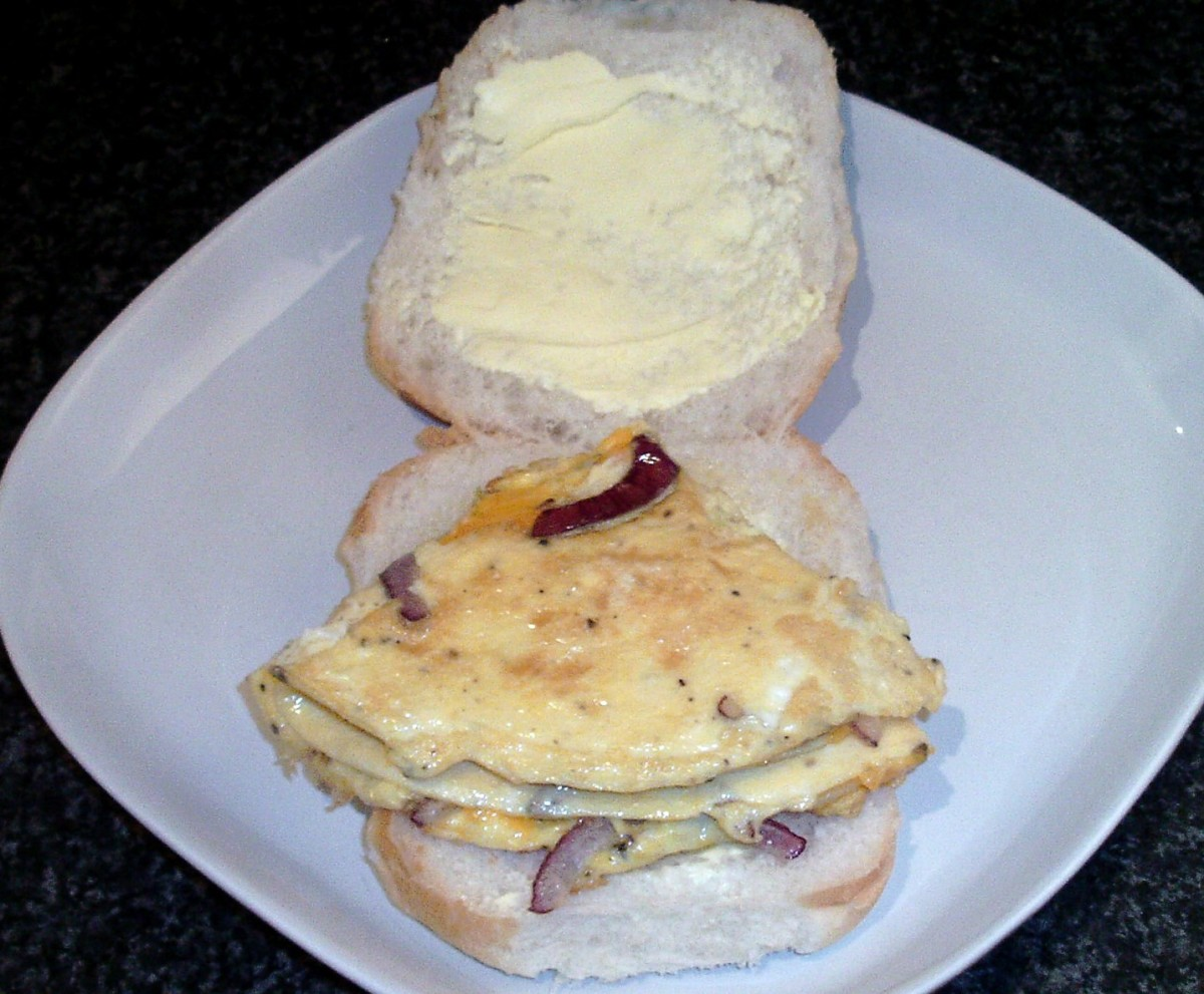 Omelette is laid on bread roll