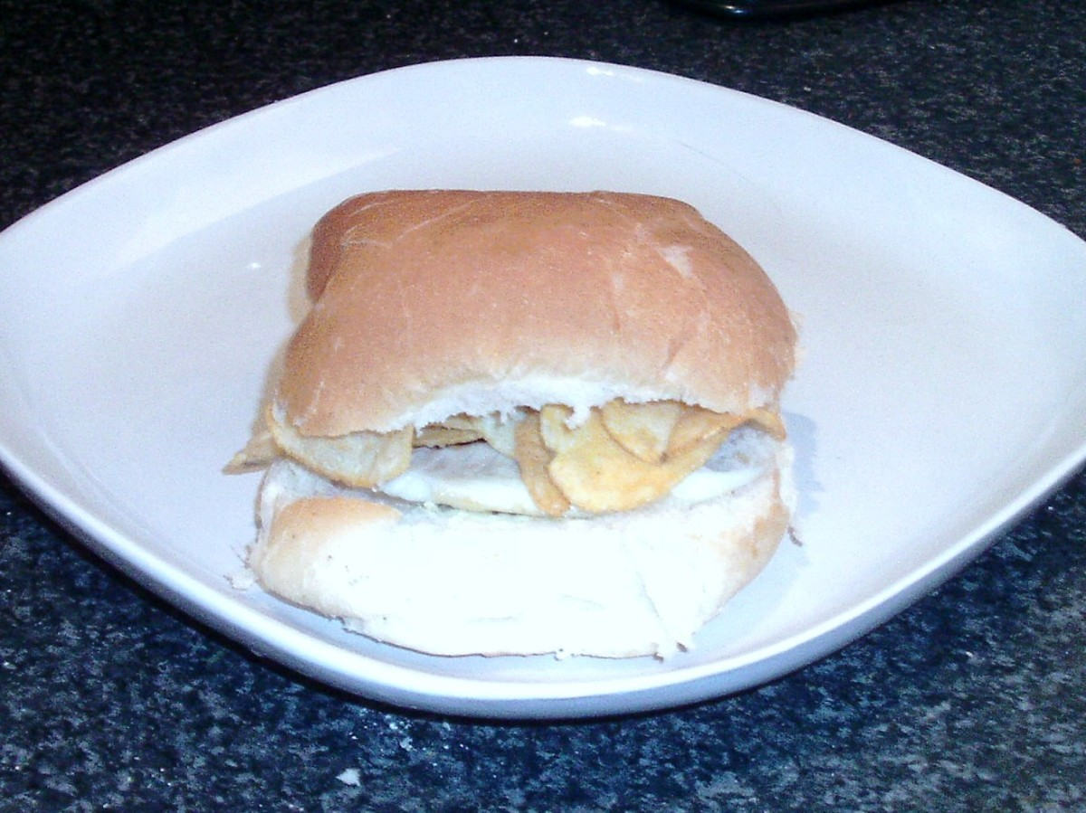 Sea bass fillet and cheese and onion crisps on a bread roll