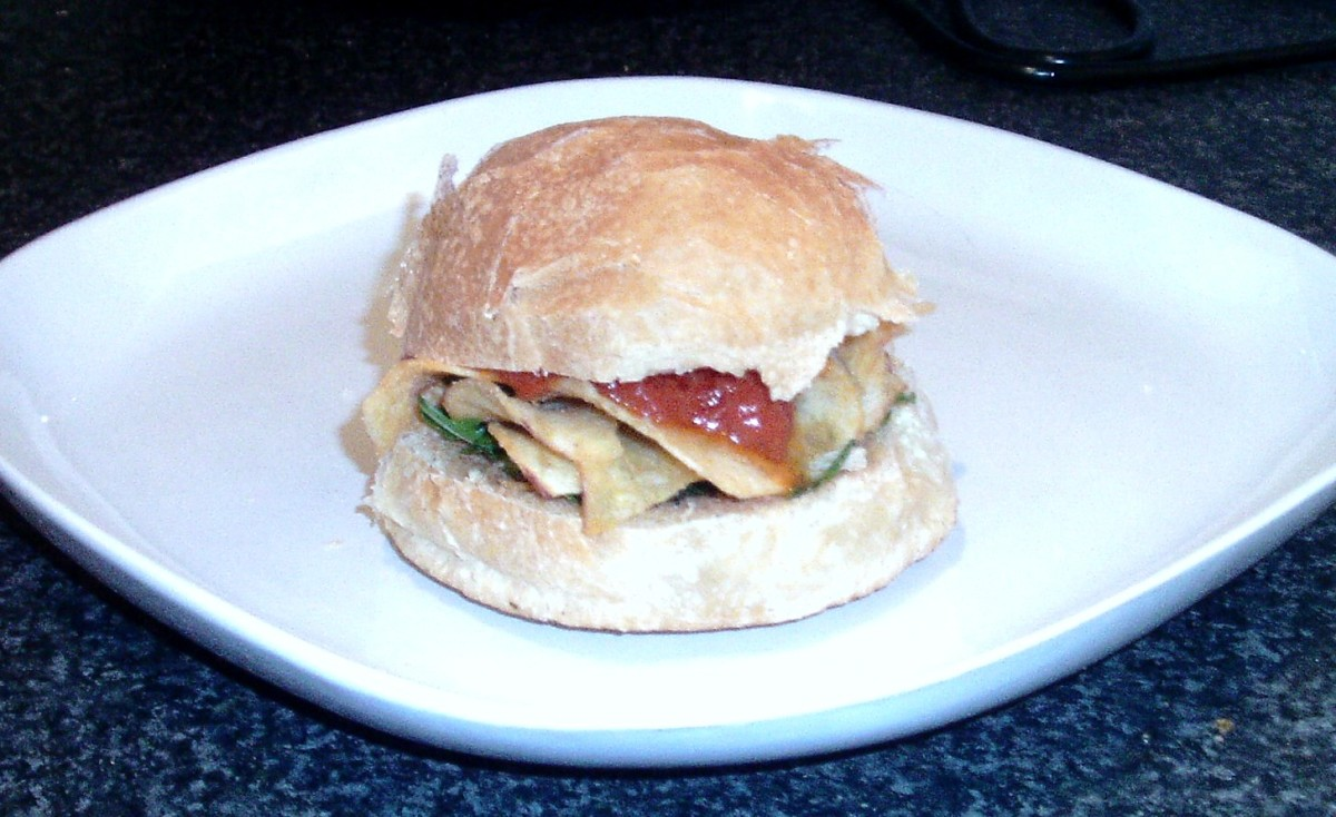 Closed over cheese and onion crisps roll with rocket and tomato sauce