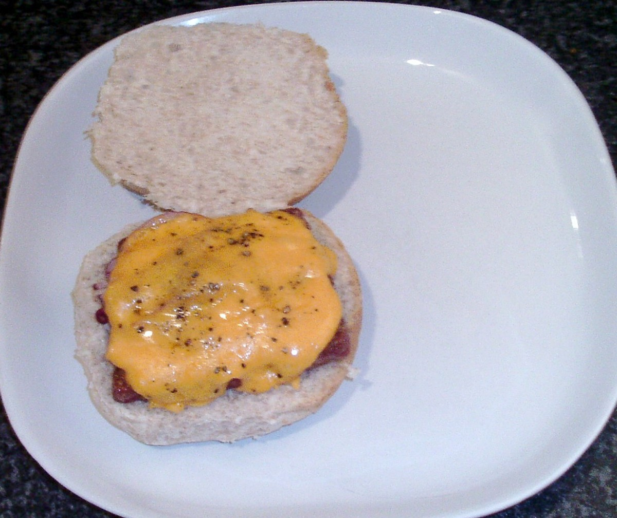 Cheesy sausage is placed on bread roll