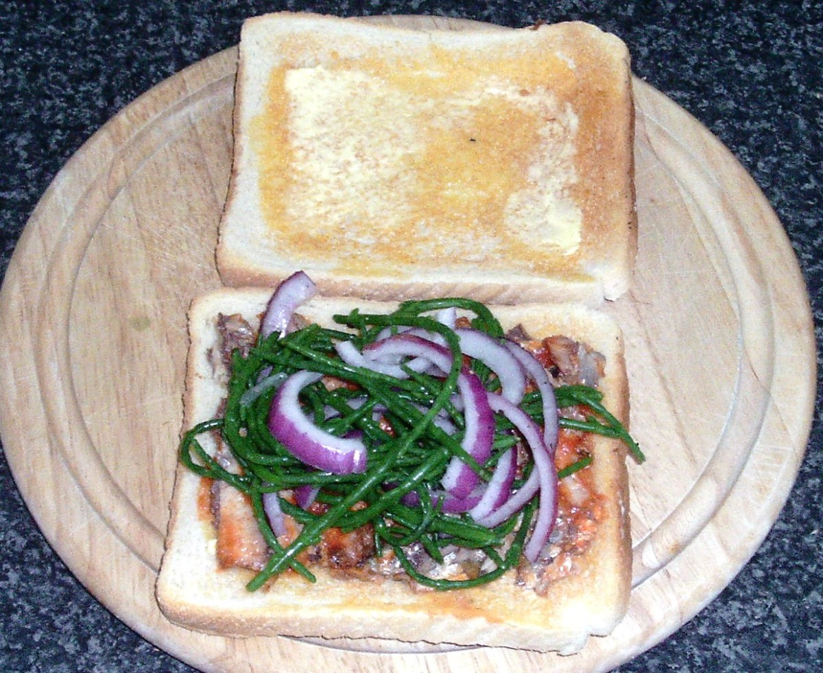 Samphire and onion is arranged on top of sardines