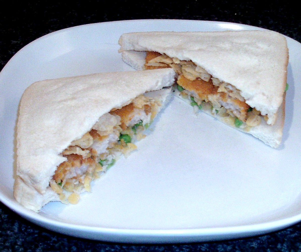 Fish fingers, green and yellow peas and cheese and onion crisps sandwich