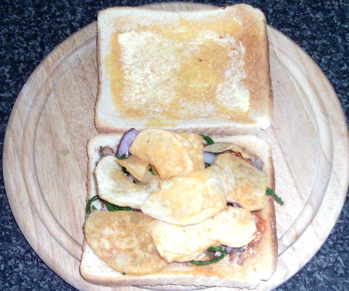Cheese and onion crisps are added to sandwich last of all