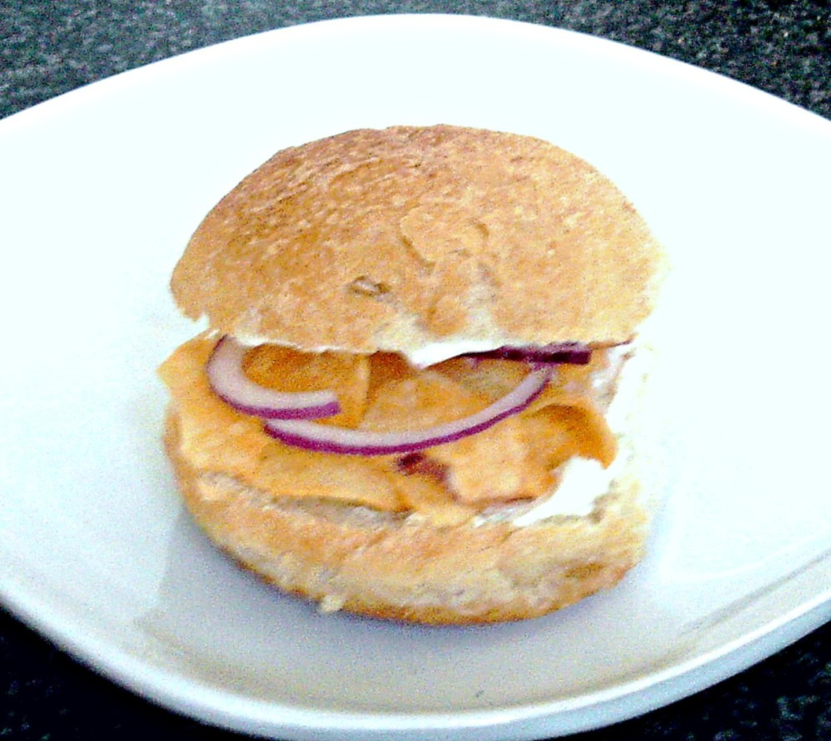 Cheese and onion crisps with cream cheese bread roll