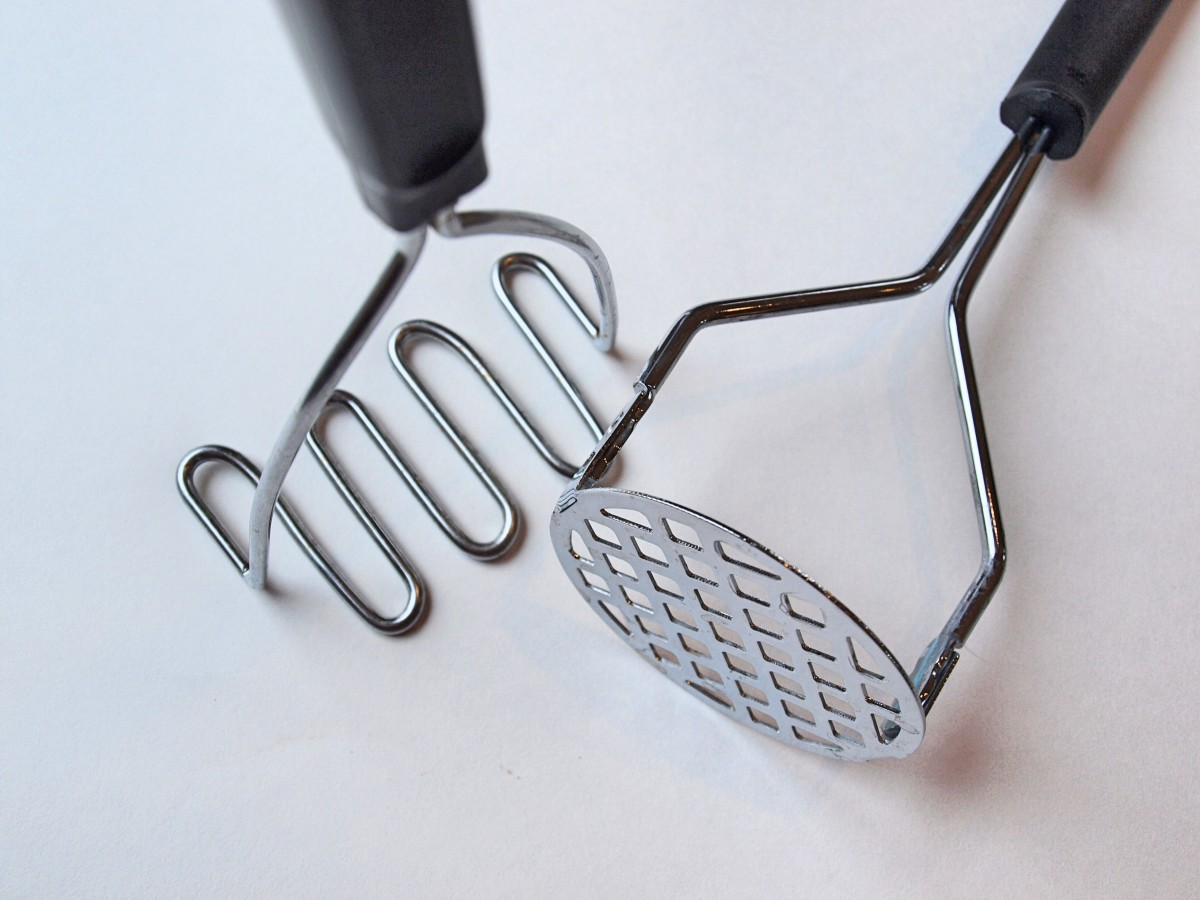 Hand held potato masher