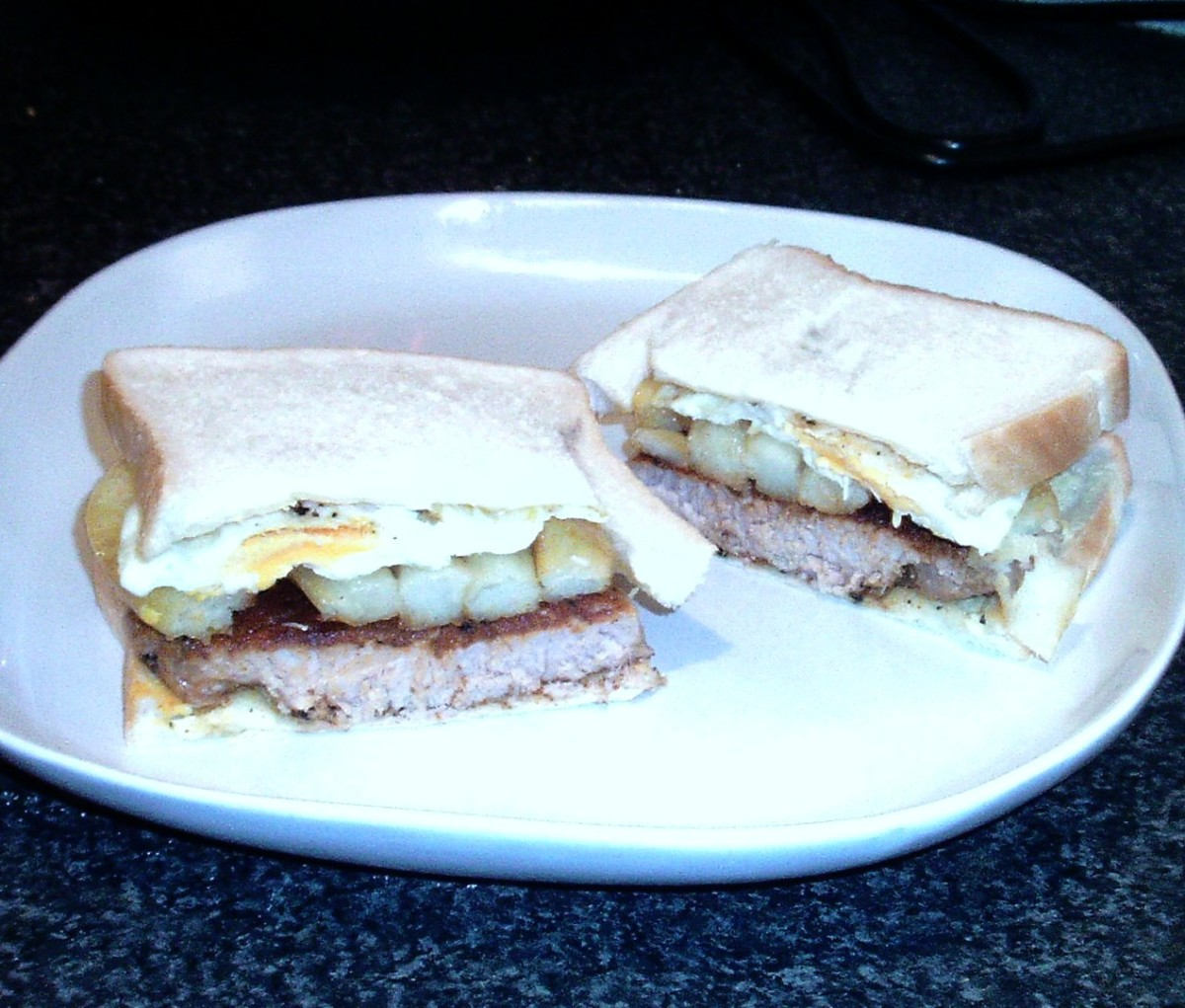 Steak, egg and chips butty is sliced and served