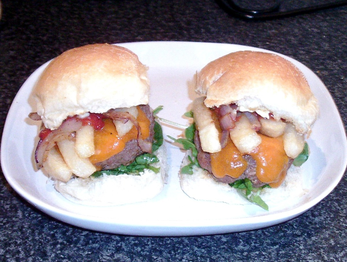 Spicy burgers and cheese with chips and fried onion butties
