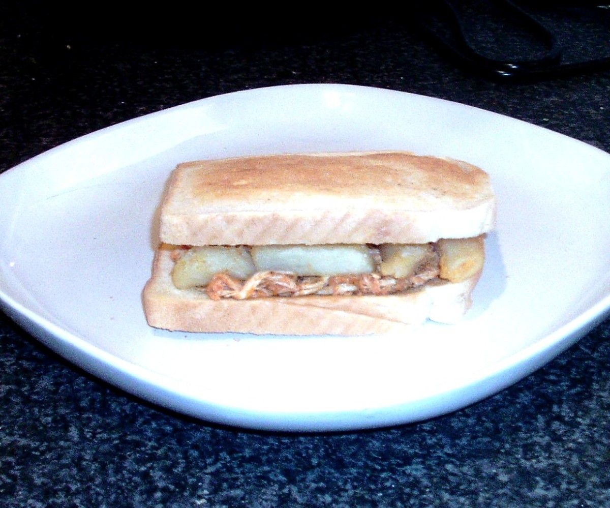 Chicken in spicy curry sauce chip butty