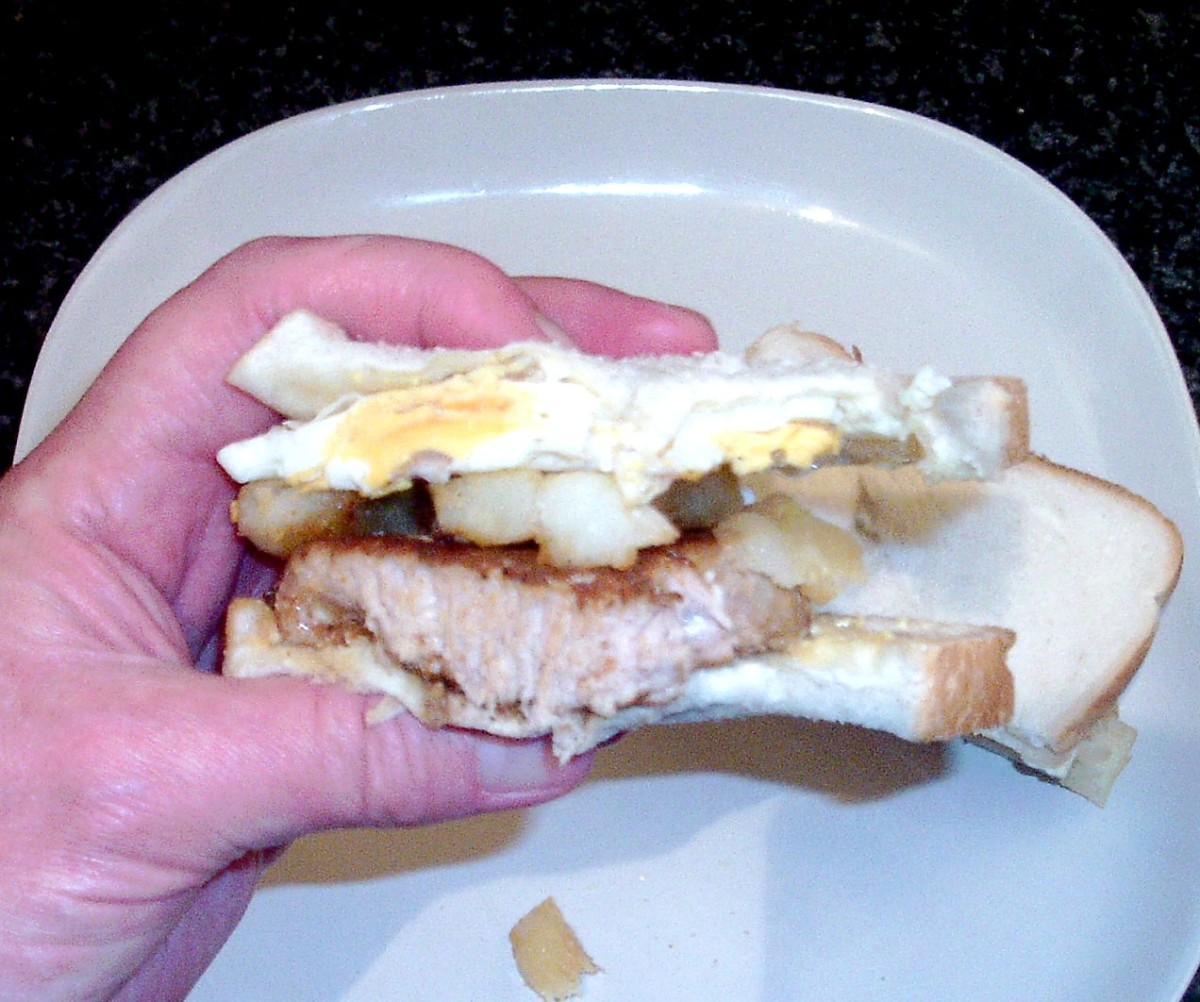 Spicy pork steak, fried egg and homemade chips butty