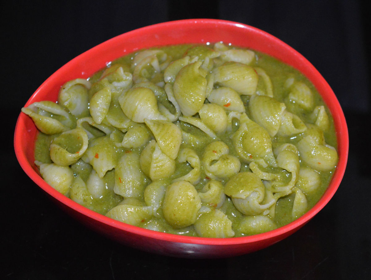 Step nine: Super tasty ginger coconut green pasta is ready! Serve it hot in a bowl. Enjoy eating.