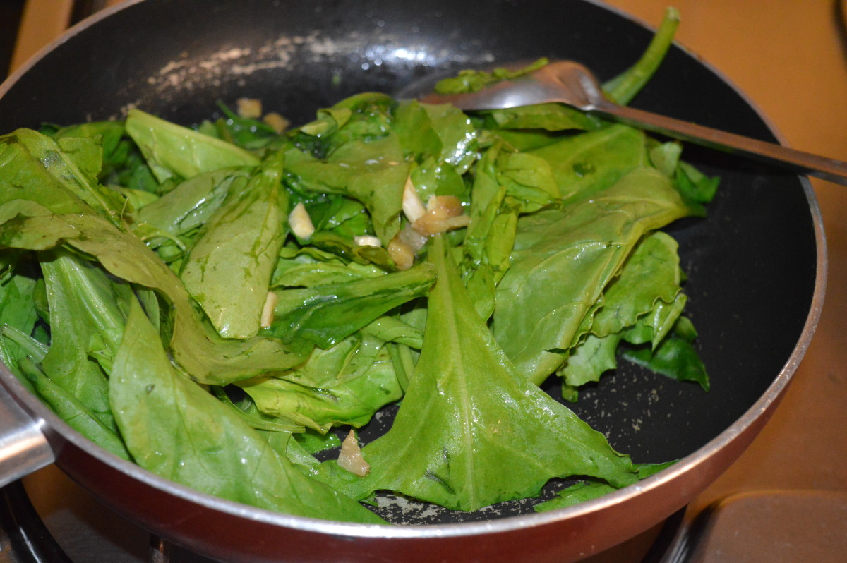 Step three: Add spinach to the sauteed ginger, garlic, and pepper corn.