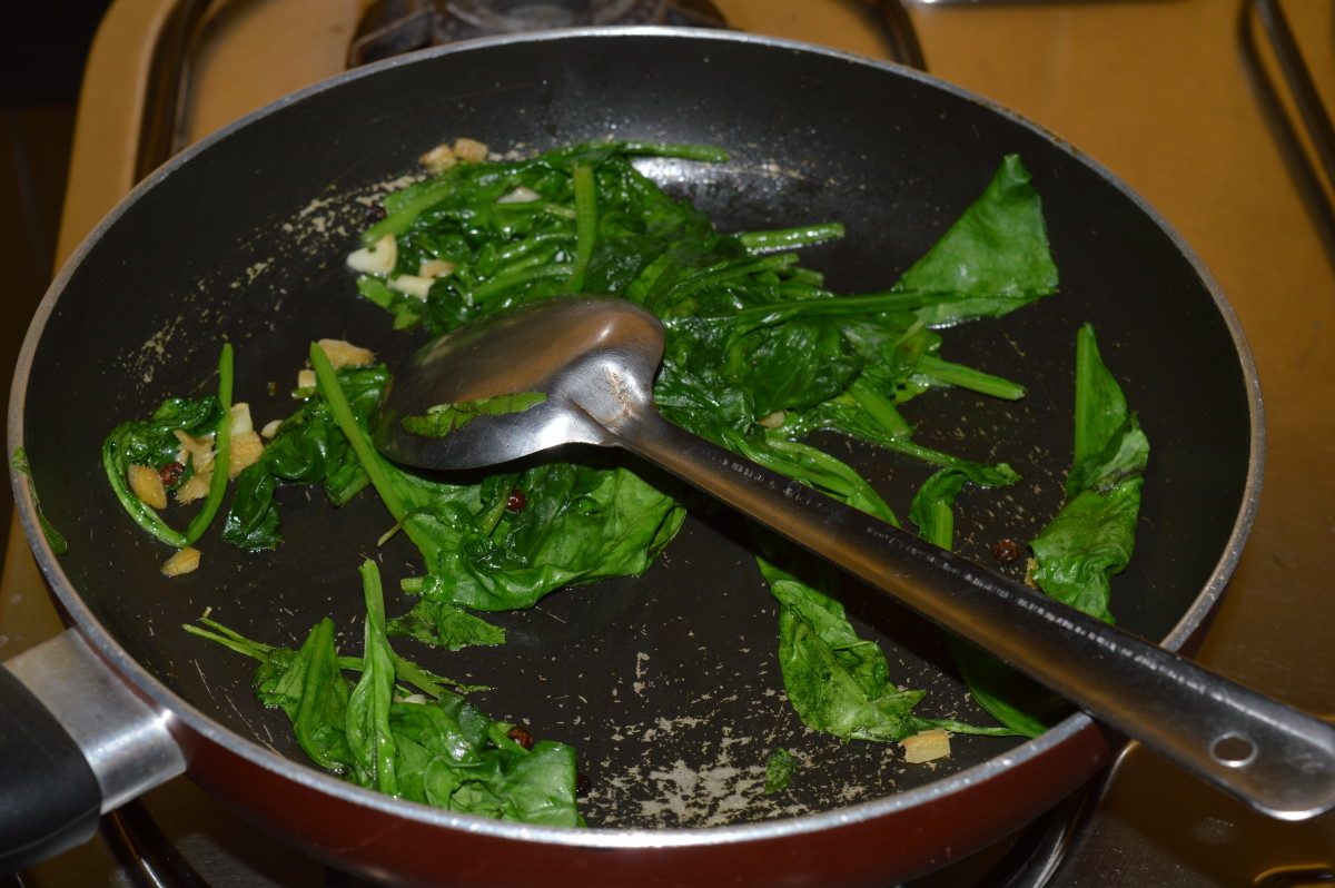 Step four: Saute spinach till they wilt completely.