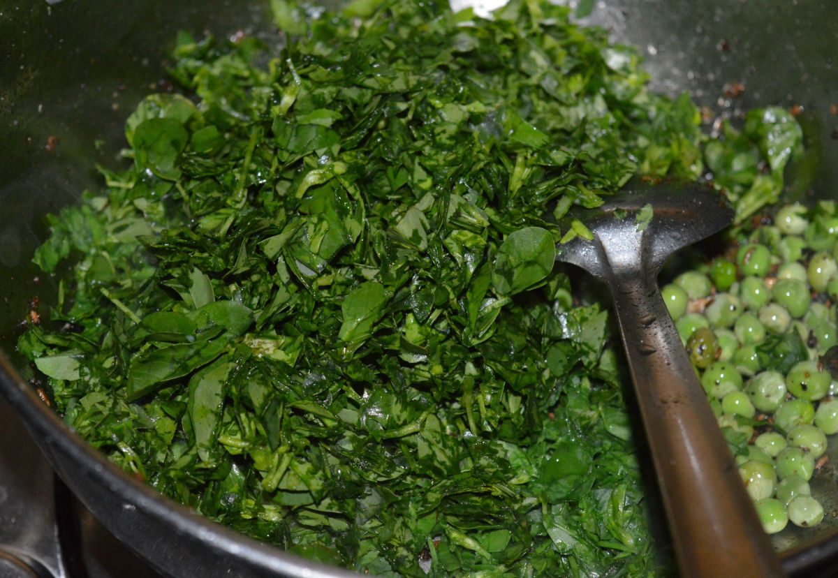 Step four: Throw in chopped fenugreek leaves. Saute on a medium-high heat for about 4-5 minutes or till fenugreek leaves completely wilt and get cooked.