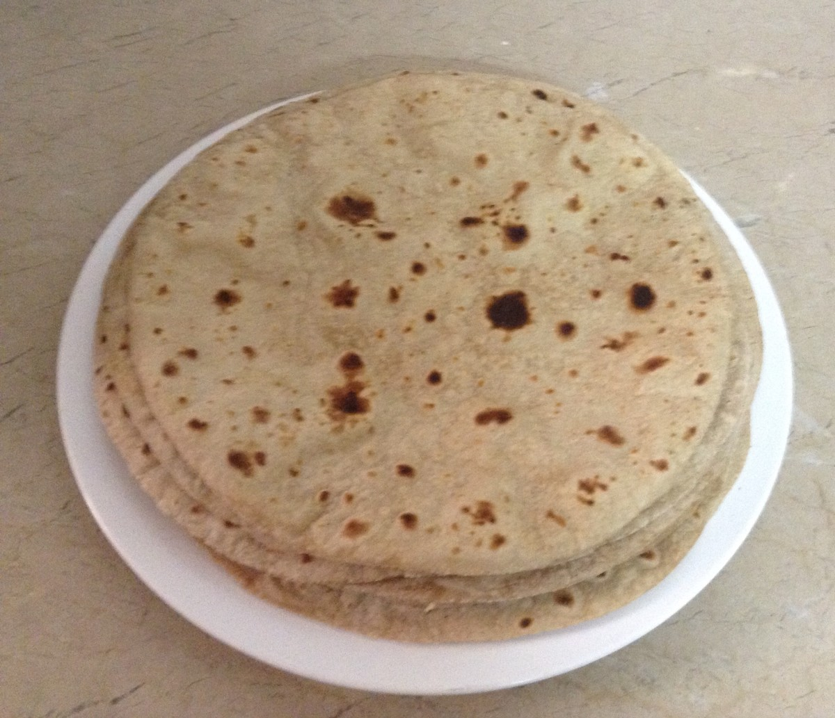 Use all the other pieces of dough to make the other Chapatis.