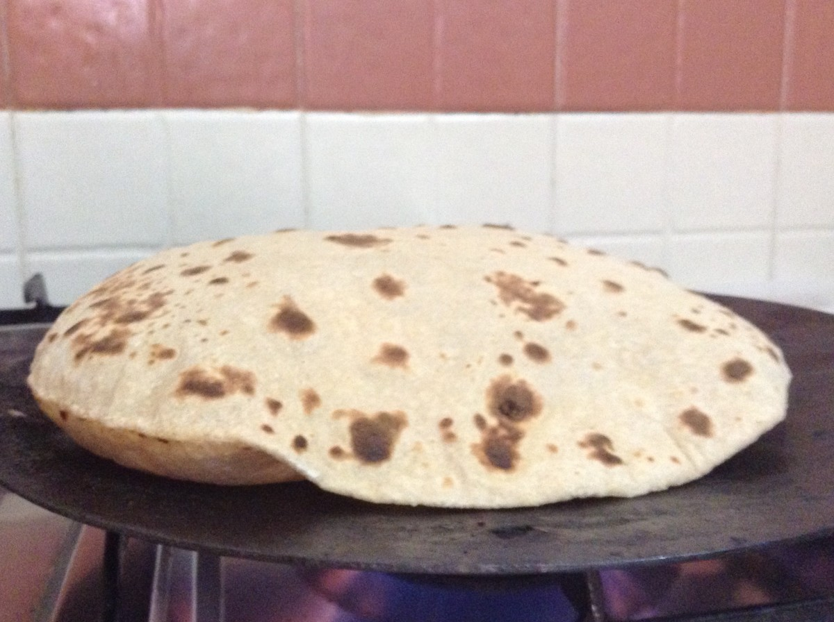 Flip it over. Press and rotate it for half a minute. Your Chapati will start to rise.