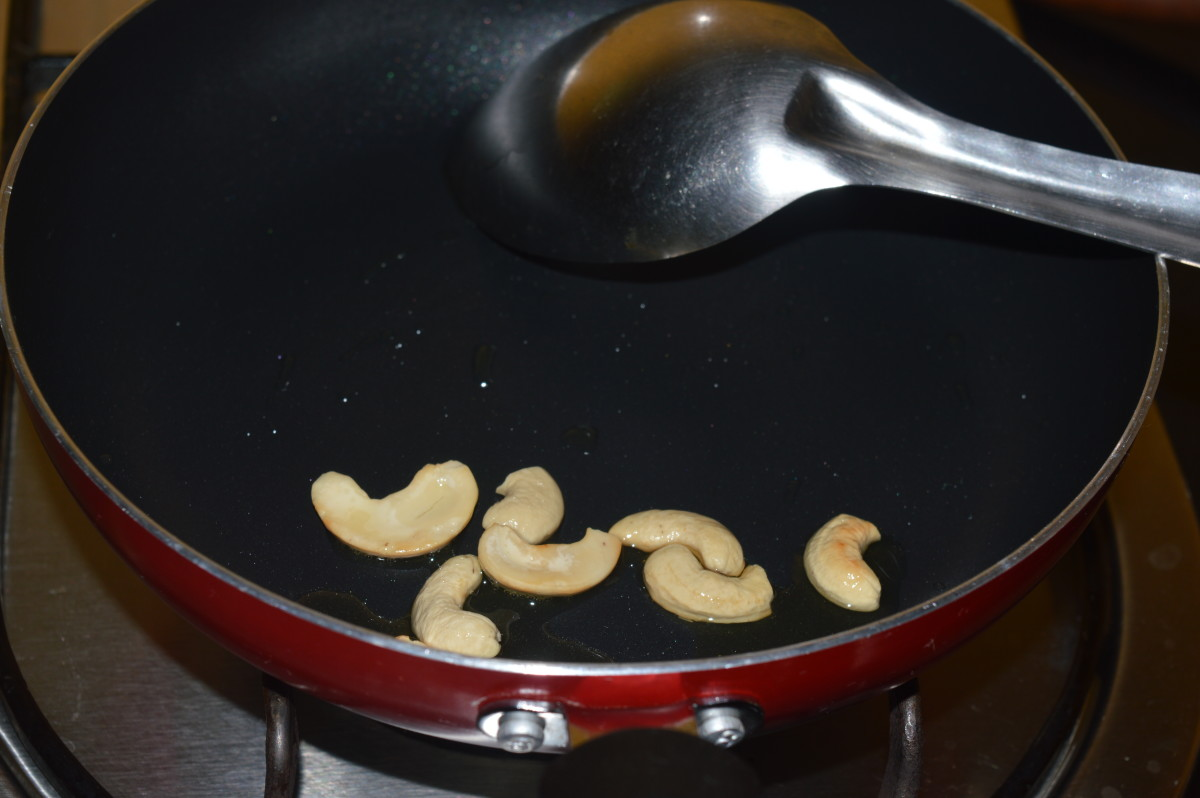 Step three: Roast cashew nuts in oil. Collect them in a bowl.